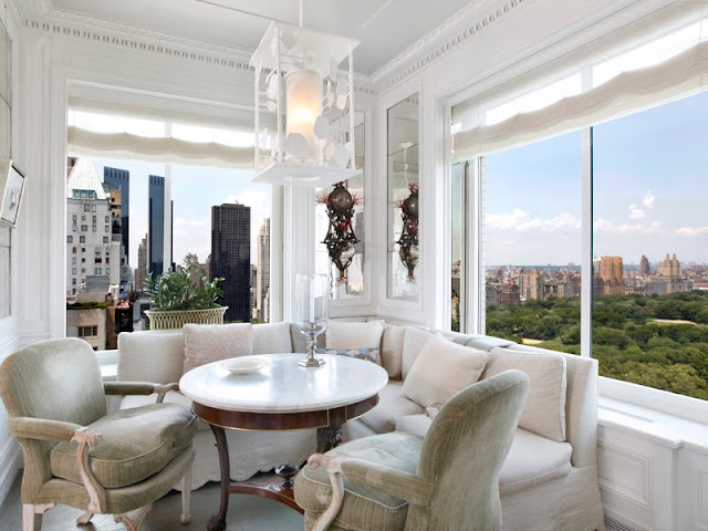 Breakfast nook with an amazing view of Central Park in NYC with a sectional sofa and armchair instead of traditional seats