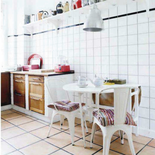 Mette+Gronlykkes+White+Dining+Table+Space+In+The+Kitchen Brightly Coloured Apartment in Copenhagen