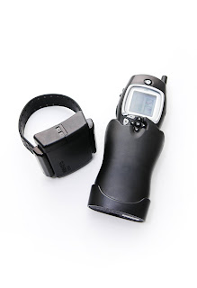 An ankle monitor and tracking device