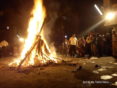 People Praying to the Holika Dahan bonfire