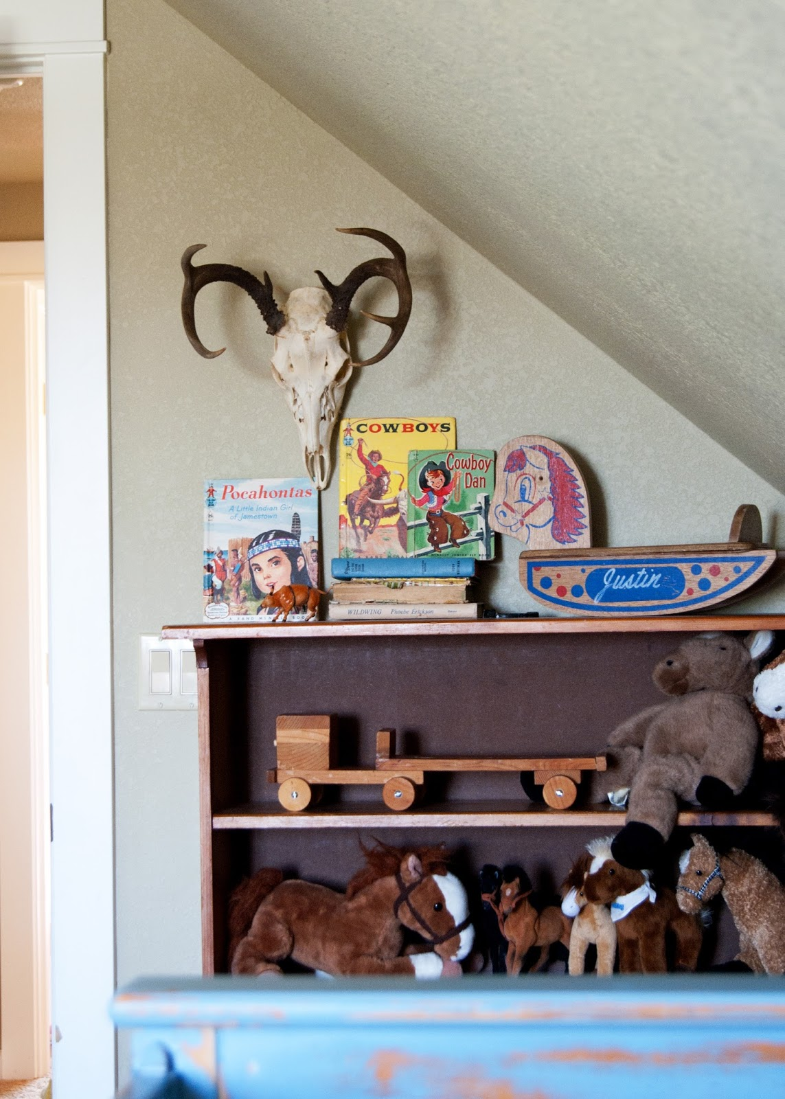 Deer antlers, vintage rocking horse and western children books