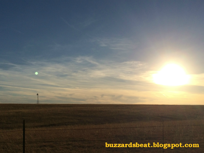 The sun and the moon both visible on the plains of Kansas