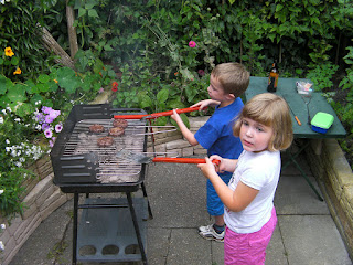 flipping burgers on the barbecue