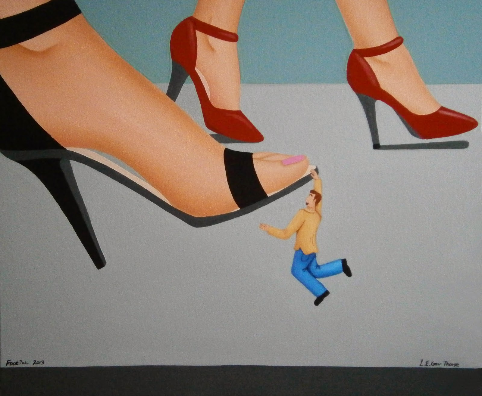 A shrunken man hanging off of the front of a woman's sandal