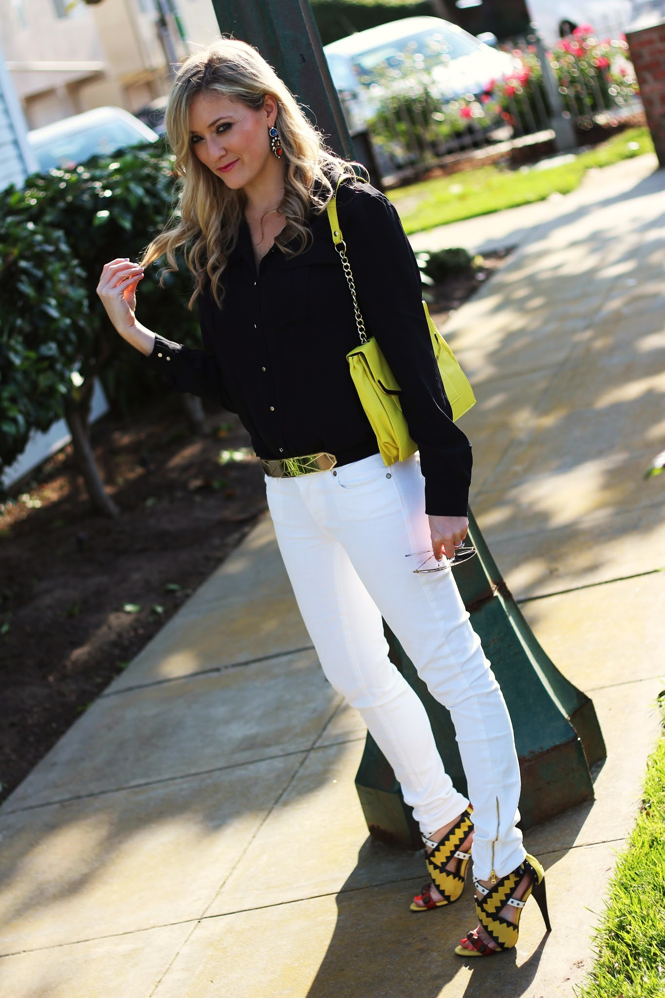 black blouse, yellow Olivia and Joy, Sunglasses Warehouse, Paige Denim, Benevolent Jewels, gold belt