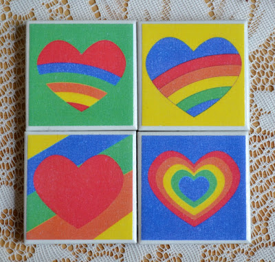set of four magnets with rainbow hearts