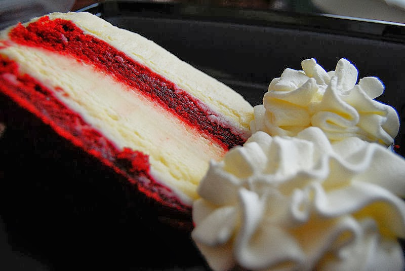 Red and white cheesecake with whipped cream