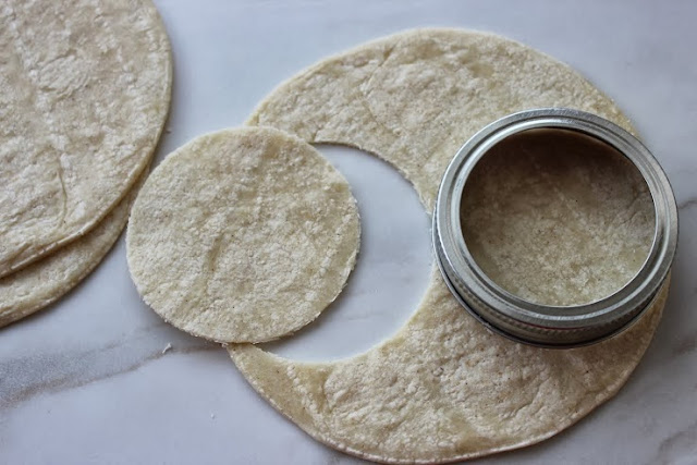 Step 5: Press each circle into the cup of a mini muffin pan, folding ...
