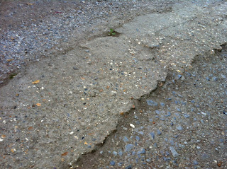 lumpy uneven paving that wheelchair wheels are prone to catching on and making you land on your chin #2