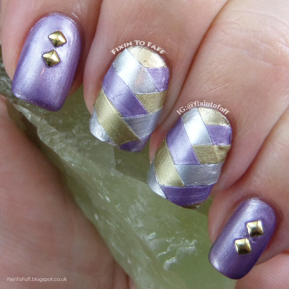 Fishbraid, or fishtail braid nail art using tape and metallic foil finish polishes, accented with studs.