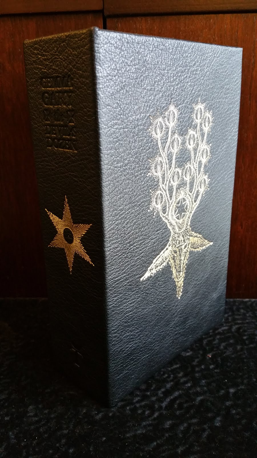 The Book Is Protected By A Full Goat Leather Solander Box Lined With Black  Silk The Cover Is Embossed With A Stylized Goat Of Mendes With Horns  Ending In