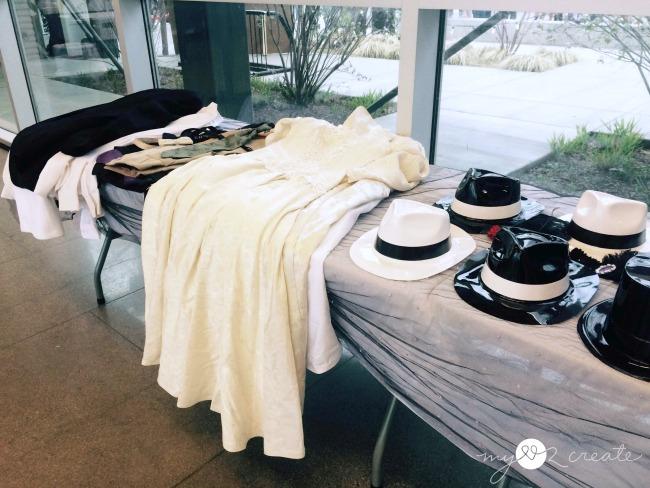 wedding chapel prop table, dresses, tuxes, and hats