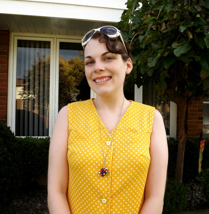 yellow dress, white polka dots, shift dress, mini dress, 1960s, 60s, retro style, Jackie O sunglasses, Rubik's cube necklace, Georgia Griffin, vintage style, vintage fashion, Suzanne Amlin, A Coin For the Well blog, Windsor Ontario fashion blog, Windsor style blog