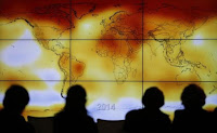 Participants are seen in silhouette as they look at a screen showing a world map with climate anomalies during the World Climate Change Conference 2015 (COP21) at Le Bourget, near Paris, France, December 8, 2015. (Reuters/Stephane Mahe) Click to Enlarge.