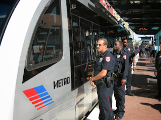 Police officer checking inside light rail cars at Houston METRO