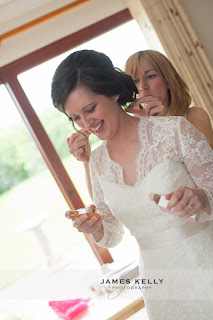 Bride wearing lace wedding gown with vintage hairstyle and makeup