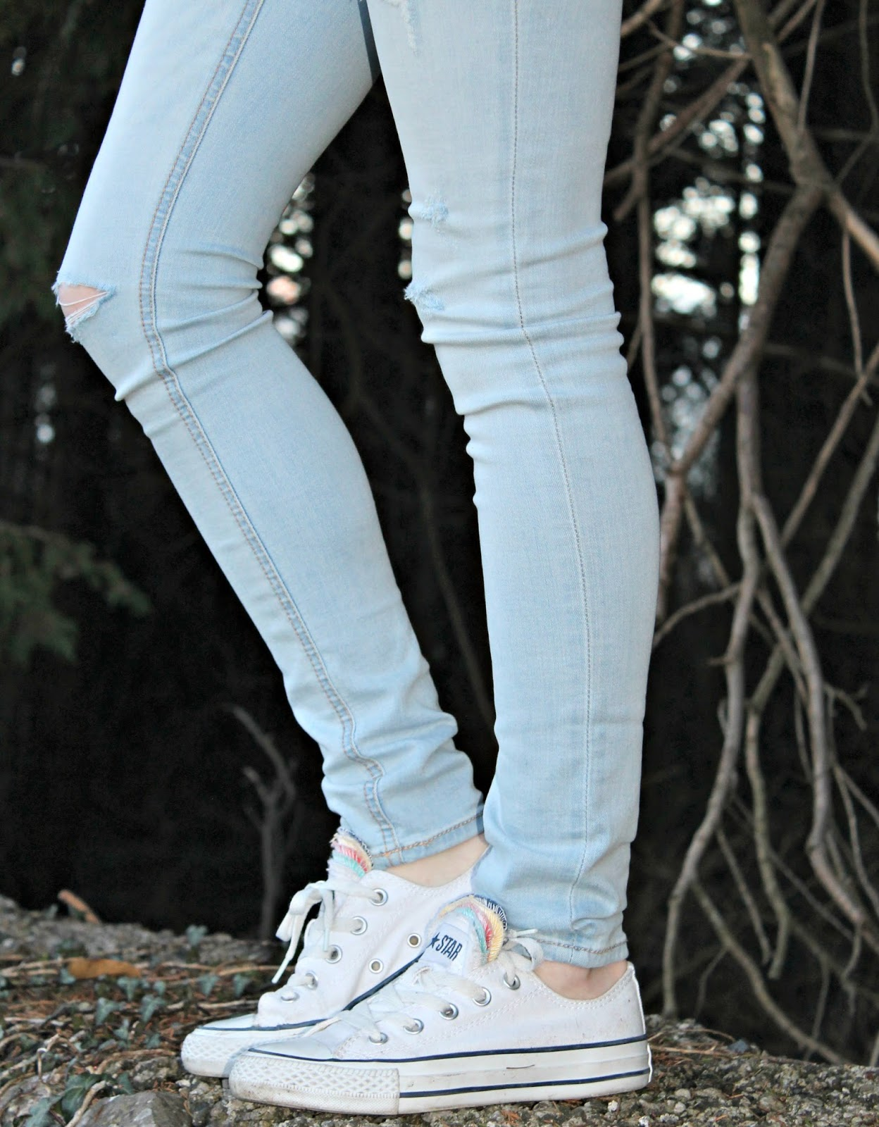 converse and ripped jeans