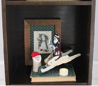 decorated holiday bookshelf 4