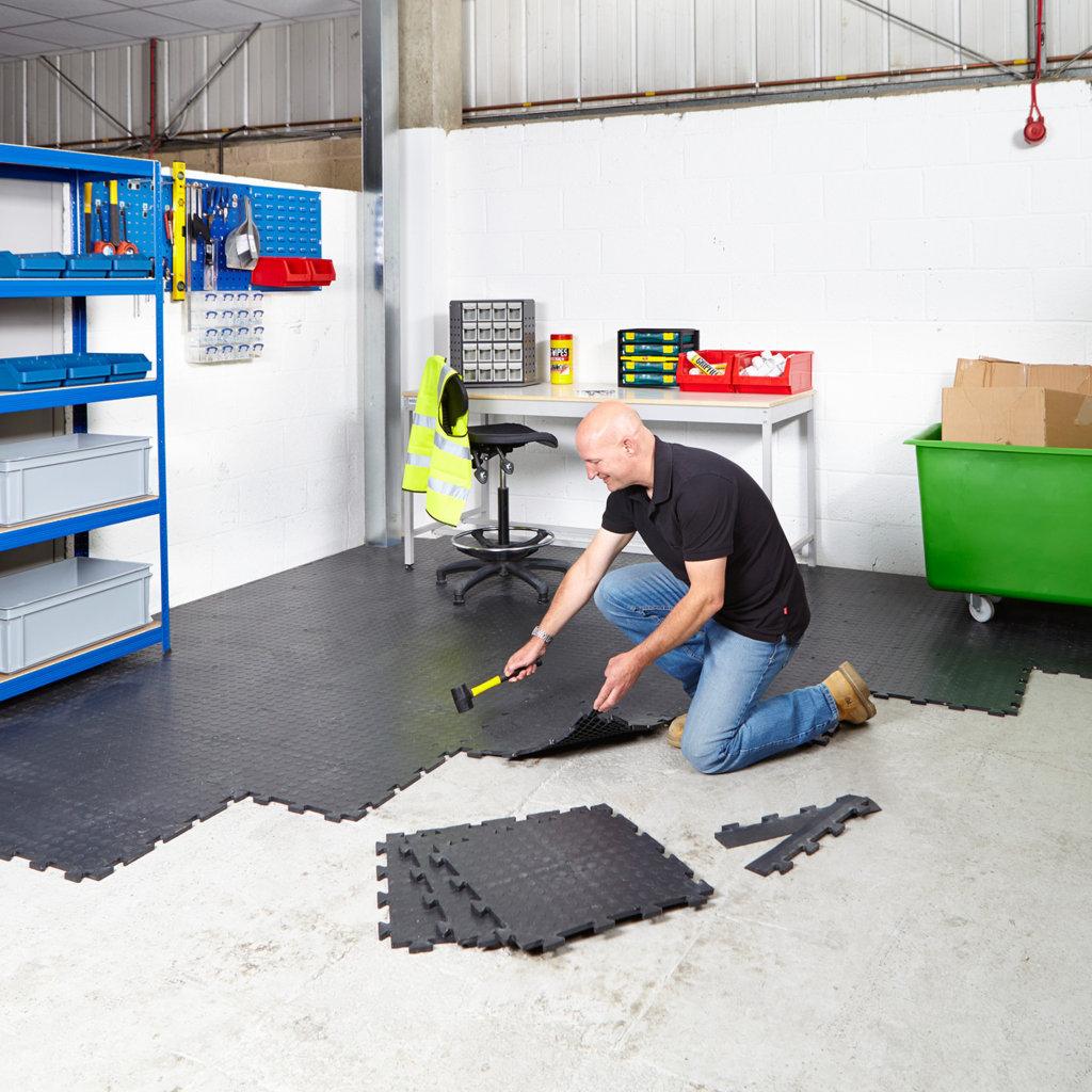 Interlocking garage floor tiles of the flooring