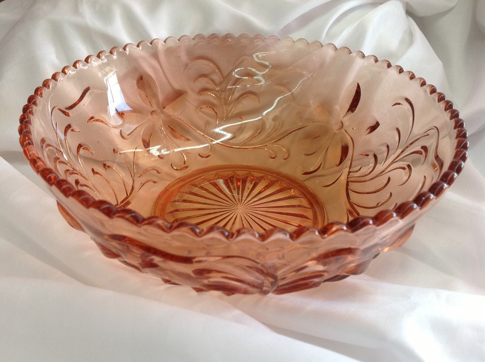 pink glass bowl with filagree engraved pattern
