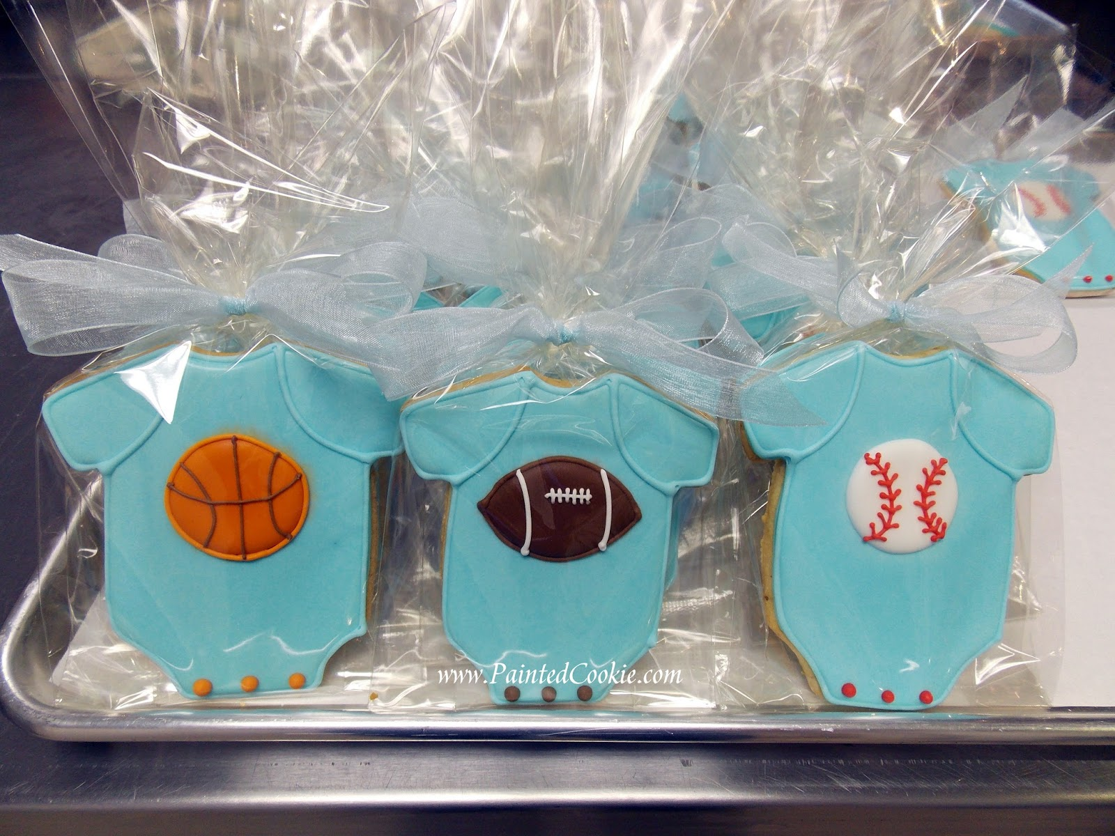 favors for a baby boy shower requesting a sports theme