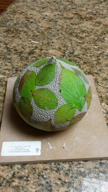 Ceramic pottery vessel with leaf imprints, in progress.