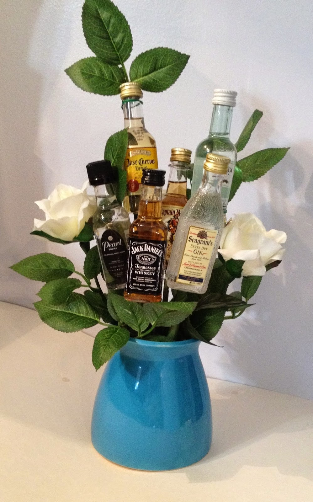 Covergirly diy liquor bottle bouquet it could be really cute to add some of the persons favorite candy or roll dollar bills into flower shapes i dont think this is going to be my last reviewsmspy