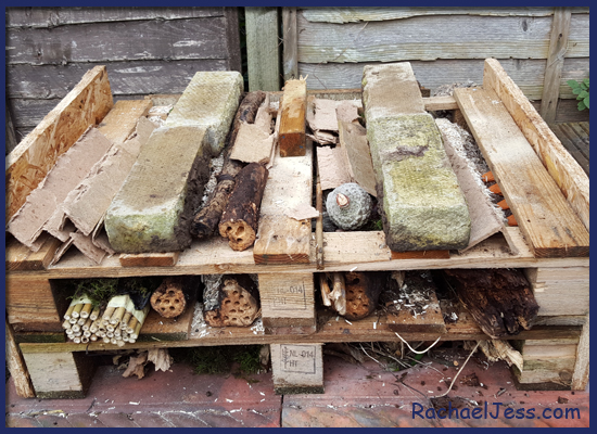 Adding all different materials and layers to our bug hotel