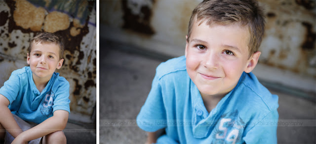 photos of a boy sitting in an alley