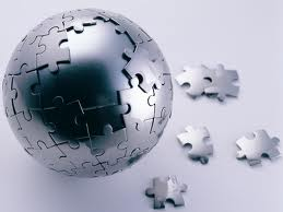 Silver metallic sphere made of puzzle pieces