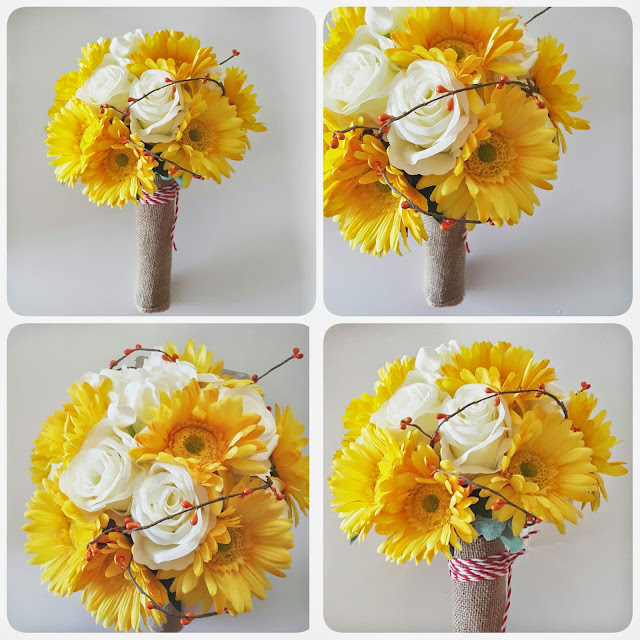 the rustic bouquet of yellow gerber daisy and white roses wrapped with burlap