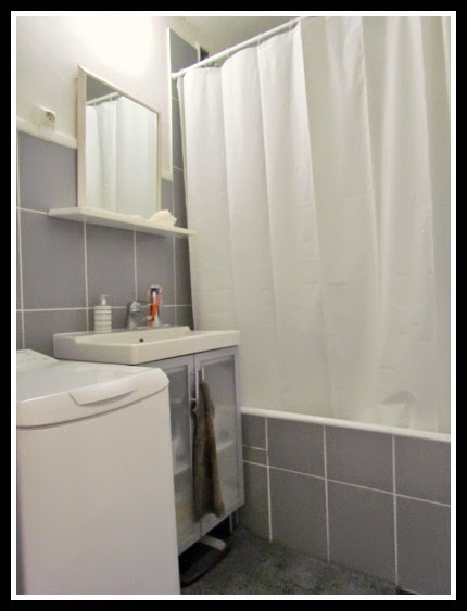 In a tiny bathroom, close the shower curtain and use a minimal color palette