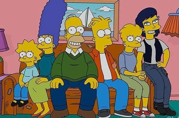 Lisa (à direita) posa para foto de família ao lado de namorada (Foto: Reprodução)