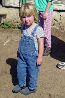 kid wearing overalls