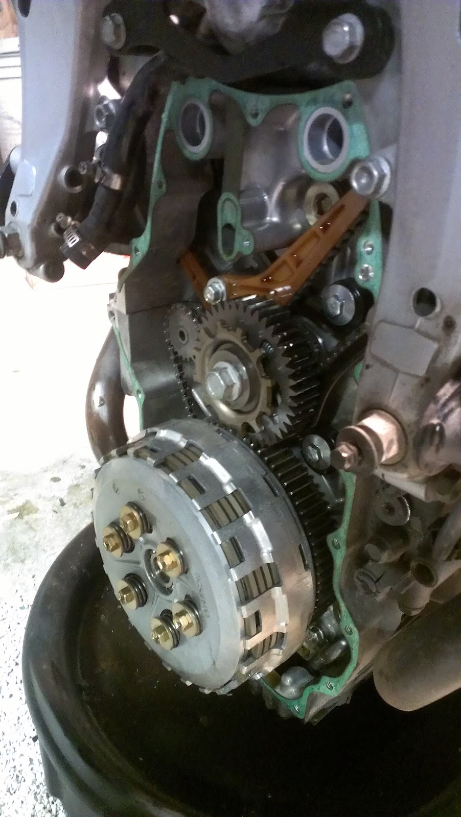 There is a most excellent diy guide on www st owners com which covers the removal of the front case to deal with replacing the clutch so i ll not say much