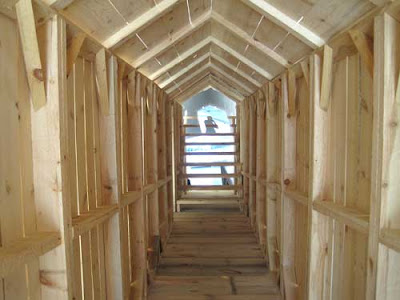 Inside of the structure, like a tiny covered bridge