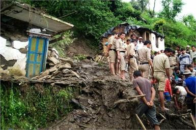 Rescue workers at bikona village press trust of india