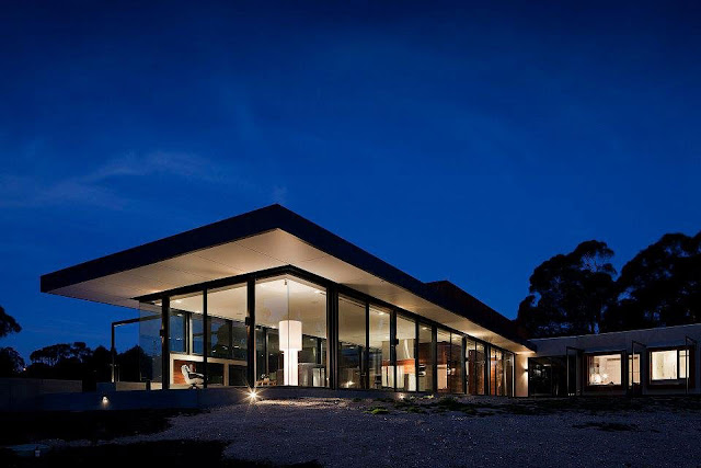 Rectangular Shape, Glass Windows, Black Trims and Wooden Wall Siding