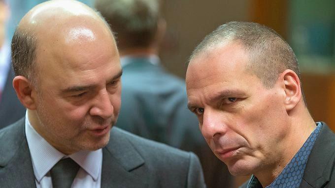 Ο Επίτροπος Νομισματικών Υποθέσεων της Ε.Ε Pierre Moscovici και ο Γιάννης Βαρουφάκης.
