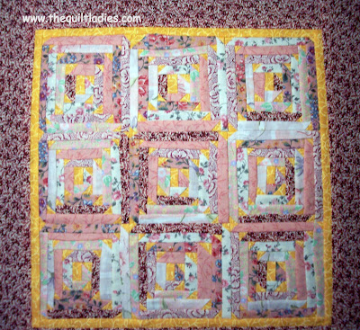 Log cabin quilt with triangle corners