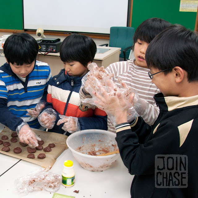 Students making cookies during Winter English Camp at Bibong Elementary in Ochang, South Korea.