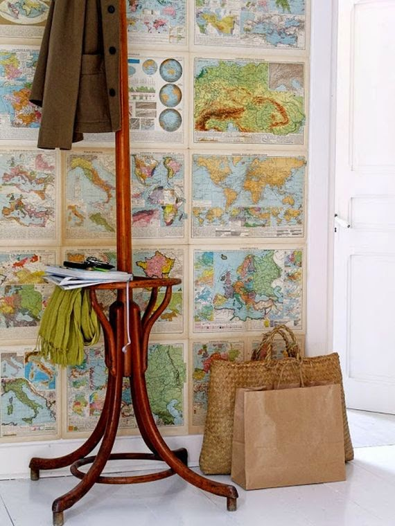 small maps hung as wallpaper in entry