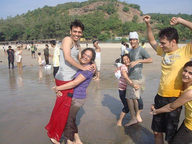 The three couple reaches on sea shore