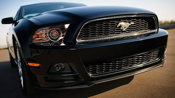 Extreme closeup of black 2013 Mustang V6 Coupe