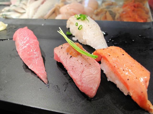 Tsukiji Fish market tokyo sushizanmai sushi zanmai ootoro fatty tuna grilled
