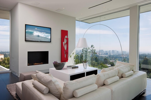 Living room with glass walls and modern fireplace