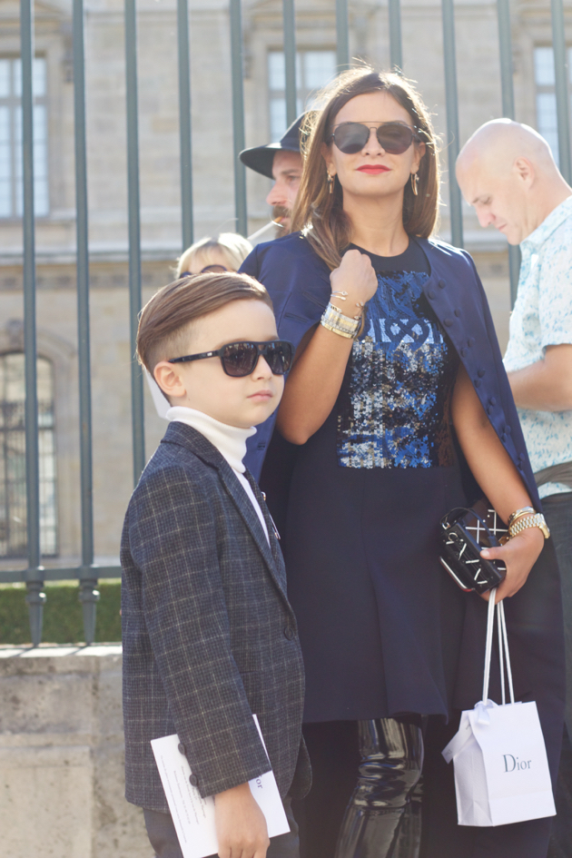 boy sharply dressed in suit after Dior show
