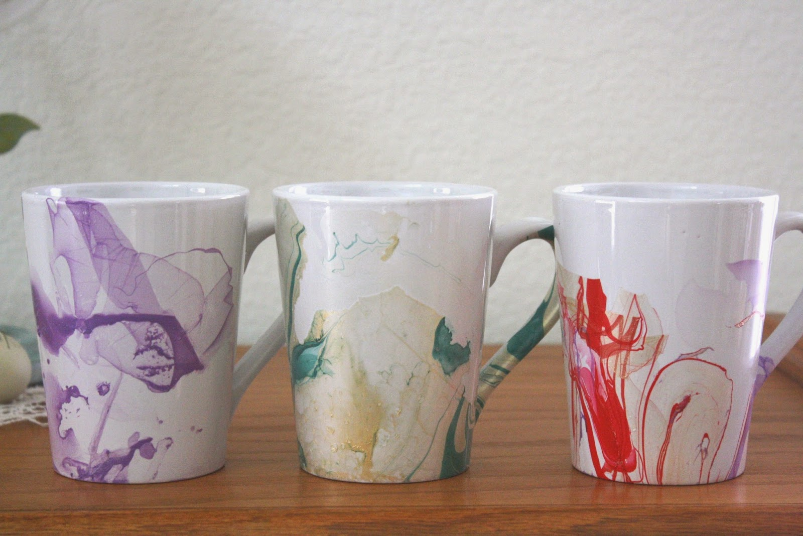 His hers and ours diy watercolor coffee mugs after all for the price of a white ceramic mug and a couple jars of nail polish you can create a truly one of a kind mug for yourself solutioingenieria Image collections