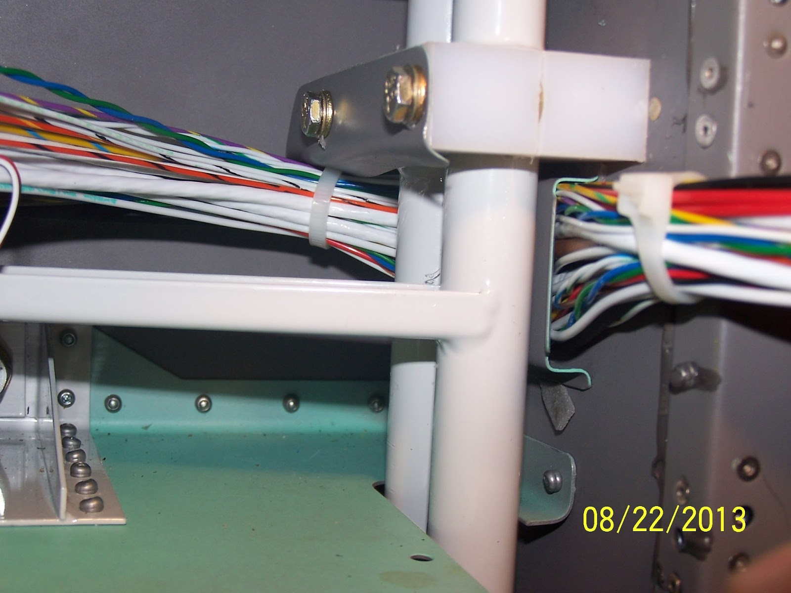 Rv 12 N79am Fuselage Wiring Harness Part 3 Final Composite Below Is A Picture Of The Shield And Bundle Hangar That Constrains Harnesses As They Run Beneath Rudder Pedal