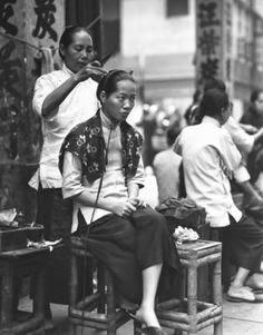 Peluquería callejera Hong Kong 1920
